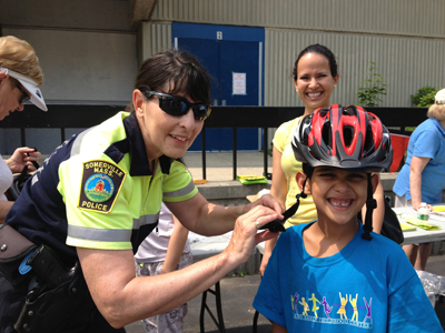 Somerville police officer and child at Bike Safety Day