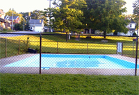 Swimming pool behind a fence