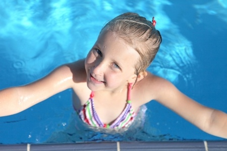 young-girl-swimming-in-pool.jpg