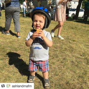 child wearing a bicycle helmet at the Ashland Farmers Market