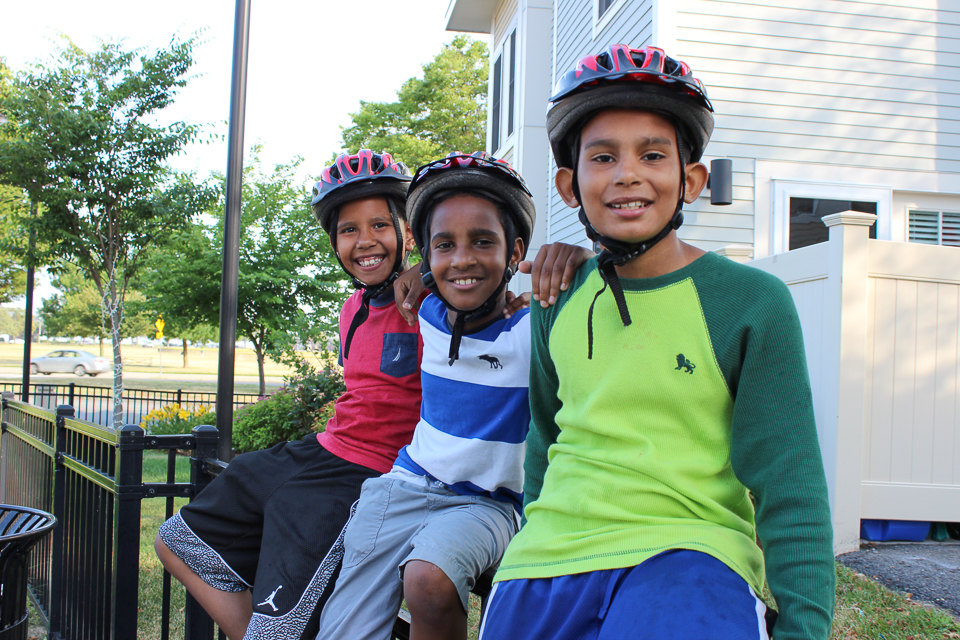Boys wearing bicycle helmets at Tierney Center in South Boston