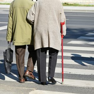 Elderly couple on crosswalk