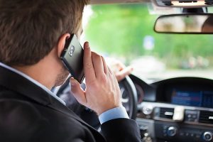 Driving talking on a cell phone in car