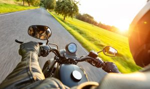 Motorcycle riding down open road