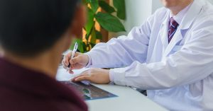 37176104 – doctor and patient in doctors office
