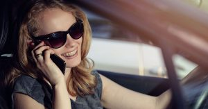 Woman talking on cell phone in car