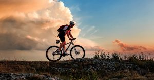 man riding bicycle in mountains