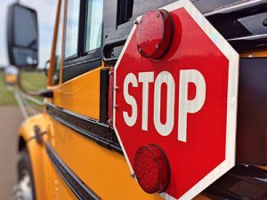 School bus with stop sign and lights