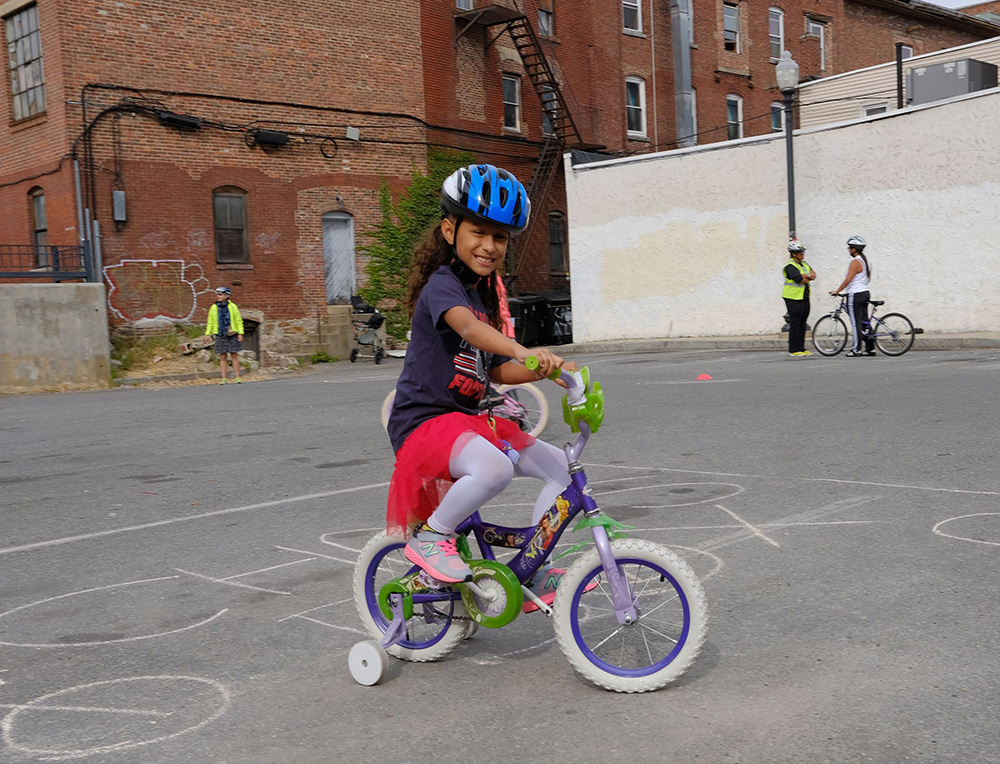 A child wearing a Project KidSafe helmet at the Lawrence Ciclovia.