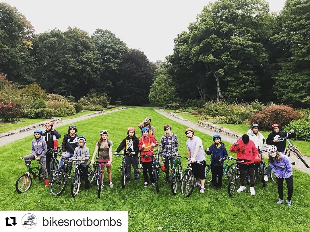 Bikes Not Bombs' Earn-a-Bike Class Wearing Bicycle Helmets donated by the Boston personal injury lawyers at Breakstone, White & Gluck