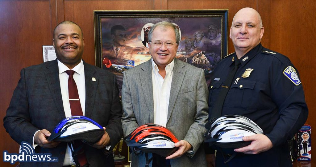 Boston Police Department bike safety and bicycle helmet donation from Breakstone, White & Gluck of Boston