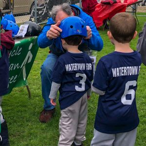 Watertown Little League Bike Helmet Giveaway. Helmets donated by Breakstone, White & Gluck.