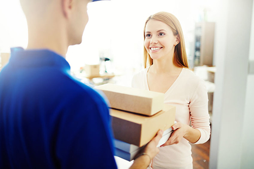 Delivery man with online purchase