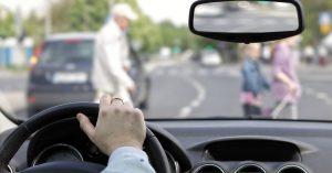 Driver and an older pedestrian at a Massachusetts crosswalk