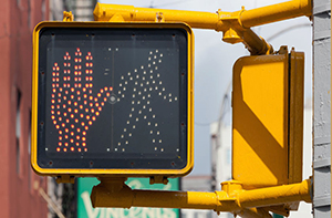 In Massachusetts, the risk of pedestrian accidents can be reduced with safety infrastructure, such as pedestrian traffic signals.