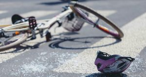 Damaged bike and helmet after a bicycle crash in Boston