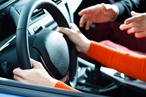 Massachusetts parent teaching a teen driver how to drive safely and defensively to prevent car accidents.