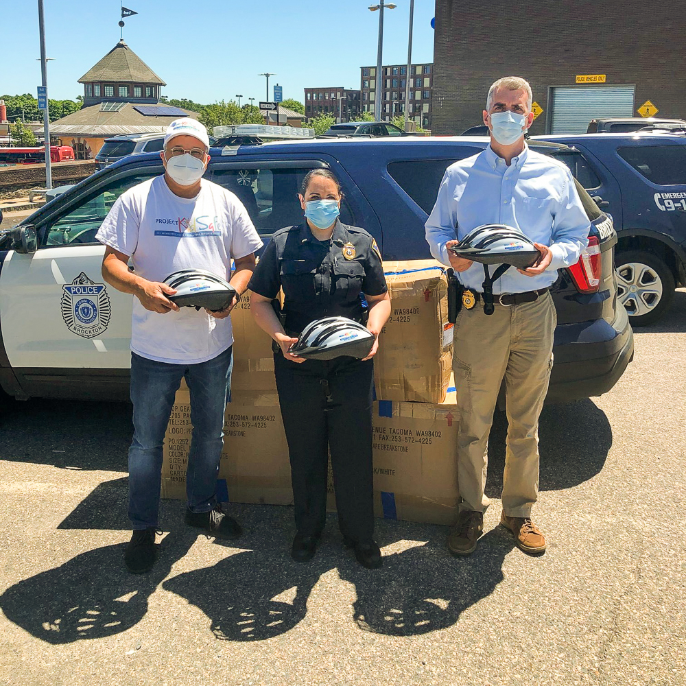 Boston Attorney David W. White of Breakstone, White & Gluck donates children's bicycle helmets to Brockton Police, as part of Project KidSafe campaign.
