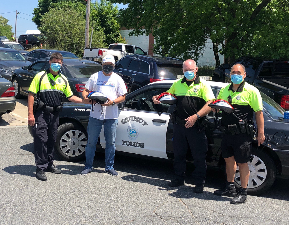 Quincy, MA Police Officers with Attorney David W. White of Breakstone, White & Gluck, which donates children's bicycle helmets to the department each year.