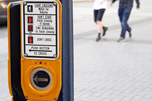 Walk signal reduces the risk of pedestrian accidents on a Boston street.