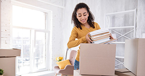 College student moving into off-campus apartment in Boston, unpacking boxes