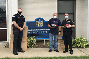 Attorney David W. White of Breakstone, White & Gluck of Boston at the Waltham Police Department Donating Children's Bike Helmets