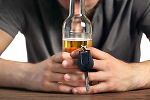 Teen considering drinking and driving, a leading cause of teen car accidents.
