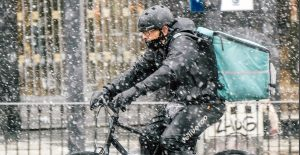 Boston cyclist riding in snow