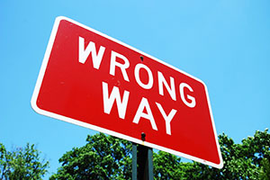 Wrong way sign alerts drivers they are traveling in the wrong direction and may cause a head-on car crash