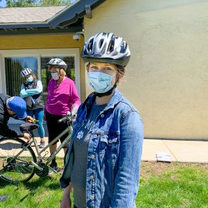 Girl wearing Project KidSafe bicycle helmet donated by Breakstone, White & Gluck.