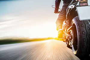 Motorcyclist riding down open road