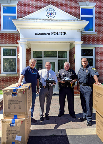 Randolph Police receive children's bicycle helmet donation from Breakstone, White & Gluck, a Boston law firm